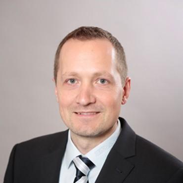 DR. THOMAS KOPPENSTEINER